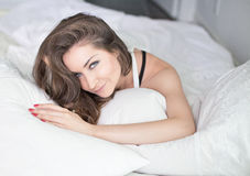 Beautiful young woman in bedroom Stock Image