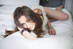 Beautiful young woman in bedroom Royalty Free Stock Photos