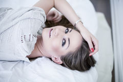 Beautiful young woman in bedroom Royalty Free Stock Images