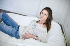 Beautiful young woman in bedroom Stock Photography