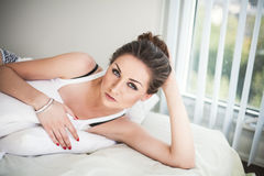 Beautiful young woman in bedroom Royalty Free Stock Photography