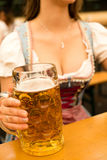 Beautiful young woman with beer stein at Munich Oktoberfest. Beautiful young woman in traditional Bavarian Dirndl with beer stein at Munich Oktoberfest stock photos