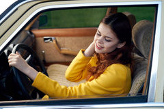 Beautiful young woman behind the wheel in the car, fashion, beauty Stock Photos