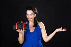 Beautiful young  woman being surprised by a gift box Stock Photo