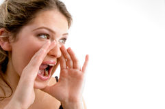 Beautiful young woman bellowing someone Royalty Free Stock Photography