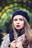 Beautiful young woman in a beret in the French style Stock Photos