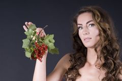 Beautiful young woman with berries red currant Royalty Free Stock Photos