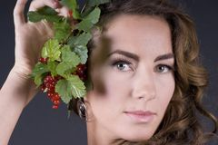 Beautiful young woman with berries red currant Royalty Free Stock Images