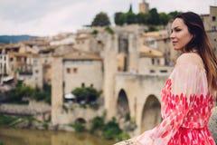 Beautiful young woman in Besalu, Spain stock photos