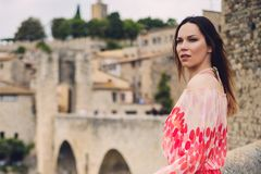 Beautiful young woman in Besalu, Spain Royalty Free Stock Photos