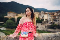 Beautiful young woman in Besalu, Spain Stock Images