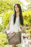 Beautiful young woman with bicycle Royalty Free Stock Photo