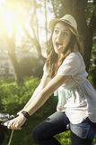 Beautiful young woman with bicycle Stock Images