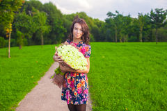 Beautiful young woman with big bouquet of white Stock Photography