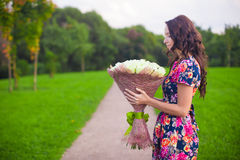 Beautiful young woman with big bouquet of white Royalty Free Stock Photo