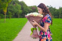 Beautiful young woman with big bouquet of white Stock Images