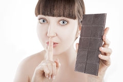 Beautiful young woman with a big chocolate bar - (Series) Royalty Free Stock Images