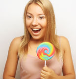 Beautiful young woman with big colorful lollipop Stock Photo