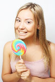 Beautiful young woman with big colorful lollipop Royalty Free Stock Photos