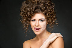 Beautiful girl with curly hairdo Stock Photos