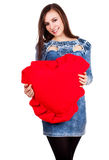 Beautiful young woman with big heart Royalty Free Stock Photos