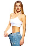 Beautiful young woman with big jeans Stock Image