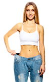 Beautiful young woman with big jeans Royalty Free Stock Image
