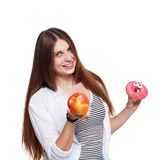 Beautiful young woman with big red apple isolated on white Stock Images