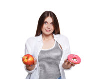 Beautiful young woman with big red apple isolated on white Stock Photography