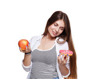 Beautiful young woman with big red apple isolated on white Royalty Free Stock Image