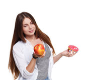 Beautiful young woman with big red apple isolated on white Royalty Free Stock Images