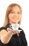 Beautiful young woman with big smile serving an espresso. Cup is Stock Photography