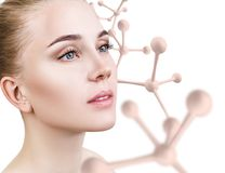 Beautiful young woman with big white molecule chain. Isolated on white background. Innovation cosmetics concept Stock Photos
