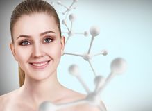 Young woman with big white molecule chain. Stock Image
