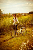 Beautiful young woman and a bike Royalty Free Stock Images