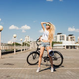 Beautiful young woman with bike outdoors Royalty Free Stock Images