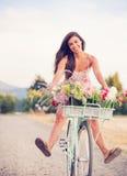 Beautiful young woman on bike Royalty Free Stock Photo