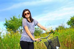 Beautiful young woman and a bike Royalty Free Stock Photos