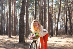 Beautiful young woman on bike in sunny park Royalty Free Stock Photos