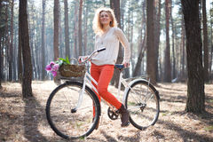 Beautiful young woman on bike in sunny park Royalty Free Stock Photography