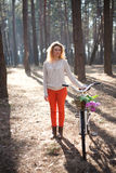 Beautiful young woman on bike in sunny park Royalty Free Stock Image