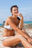 Beautiful young woman in a bikini on the beach Stock Images