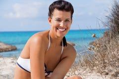 Beautiful young woman in a bikini on the beach Stock Photo