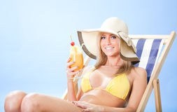 Beautiful young woman in bikini  dirking cocktail Royalty Free Stock Photo