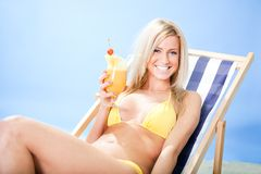 Beautiful young woman in bikini  dirking cocktail Royalty Free Stock Photos