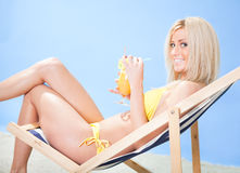 Beautiful young woman in bikini  drinking cocktail Stock Photos