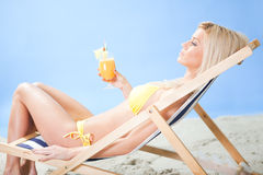 Beautiful young woman in bikini  drinking cocktail Stock Photography