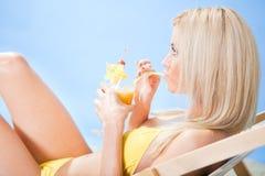 Beautiful young woman in bikini  drinking cocktail Stock Photos