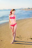 Beautiful young woman bikini pinup at beach Royalty Free Stock Image