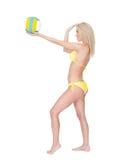 Beautiful young woman in bikini playing volleyball Royalty Free Stock Photos
